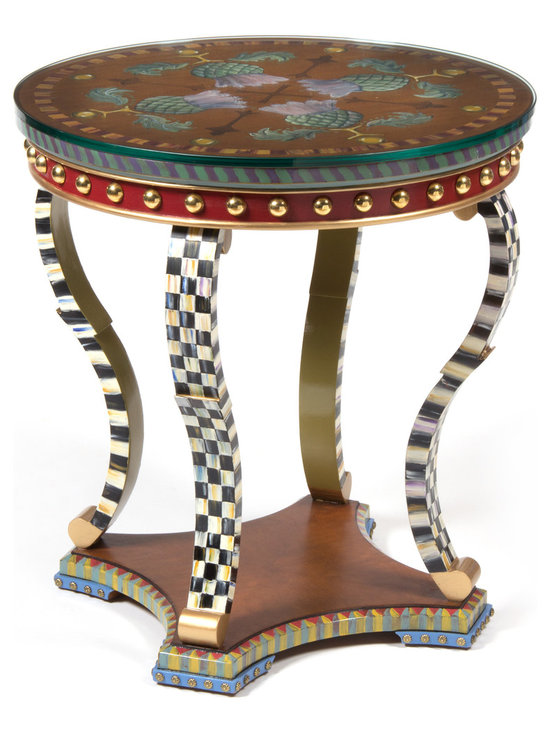 "Highland Thistle Table | MacKenzie-Childs - A masterwork of hand decoration from our artisans in Aurora adorned with signature thistle flowers, each Highland Thistle Table offers layers of decorative detail. The edge of the tabletop is striped in purple and green, followed by a decorated apron in rich Moroccan red with brass half dome beads and gold banding. Each ""S""-shaped leg features our hand-painted classic Courtly Check® pattern on the front and sides ending with gold at the base. The interior of the legs are painted in chartreuse green. The base of the table is decorated in a diamond-and-stripe motif of rose, blue, and chartreuse, and is finished with blue and brass tack feet and Courtly Check®-accented legs. Imported hardwood. Includes glass top."