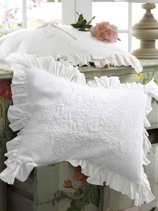 Santorini Bed Sham - Imagine yourself watching the sunset from the balcony of a secluded villa. Re-experience that peaceful bliss each night in your own home with our Santorini Bedding Collection. The exceptionally soft, 100% cotton skirted coverlet (sold separately) features an intricately quilted design created with thousands of hand-guided stitches. The quilting complements the generously gathered, double-layered skirt, finished with corner aprons and accented by pretty rosettes. The quilted standard sham repeats the appealing details and closes in the back with a bow. The result: complete comfort and contentment. Polyester filled.