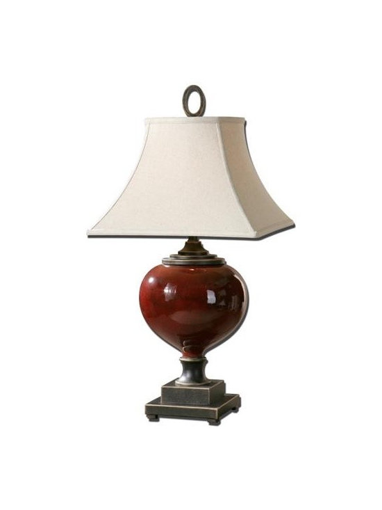 Uttermost Anka - Lightly distressed burgundy ceramic with heavily antiqued dark bronze accents. The round top, square bottom, bell shade is an off white linen fabric with light distressing.