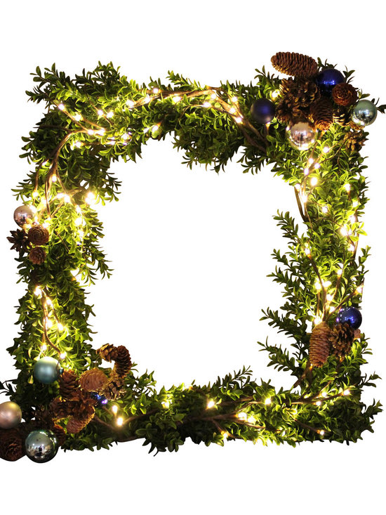 The Firefly Garden - Old World Wreath - Illuminated Floral Design - In old European legends, the boxwood tree is a symbol of immortality because its leaves flourish through all seasons and across long expanses of time. Our Old World Wreath brings the warmth and holiday tradition of Europe to your home or business as a door or window decoration or a centerpiece for the dining table.  The lights on this wreath are battery operated