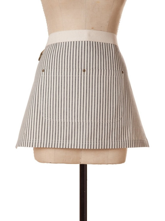 """Birdkage - Brittany Mini Half Apron, Black - Details include:-Cream natural cotton webbed waistband-Blue jean rivets at the pockets & contrasting topstitching-Packaged in a re-usable cotton drawstring bagMade in New York, USA16 Long x 26"""" Wide x 50"""" Ties"""