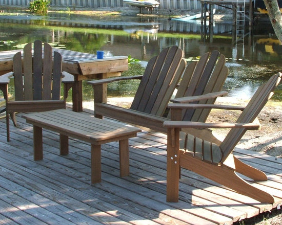 Ipe Adirondack Patio Set - Adirondack set made of Ipe. Ipe Is a hardwood from South America. This lumber is very heavy per foot as compared to other lumber and it is extremely hard. It is one of the very best materials for outdoor use. We use exterior grade hardware on the chairs and tables. The chairs are available in their natural color and the will grey gracefully over time.