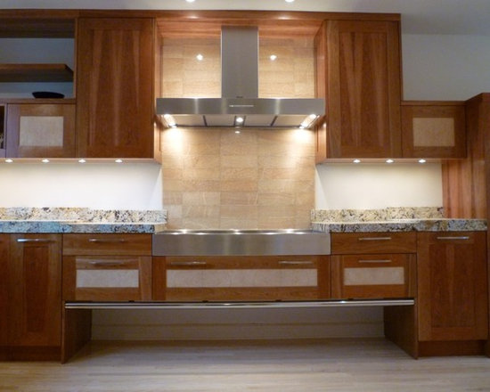 Cherry Ash - Granite tops overhangs stainless steel cookwell for custom look.  Nifty floating cabinet run also.