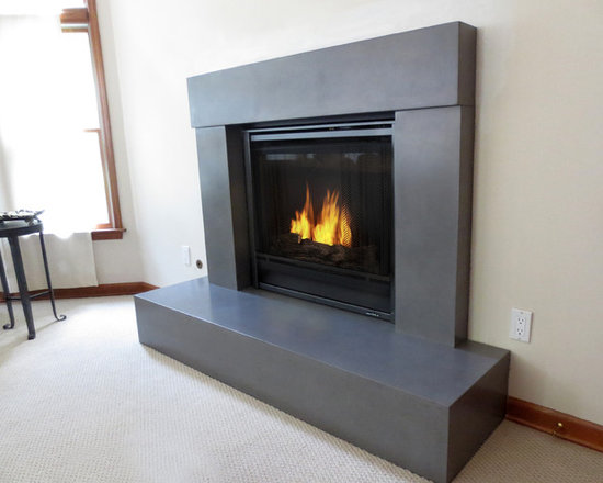 Concrete Fireplace Surrounds - Beam concrete fireplace surround for a gas fireplace fabricated by Trueform Concrete