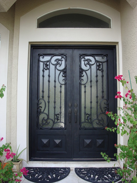Forge iron designs wrought iron doors for Door design of iron