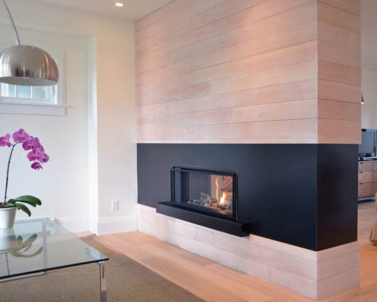 "L1 Linear Series 2-Sided Fireplace - 1600I L1 2-Sided Series shown with Long Beach Driftwood, Fluted Black Liner and 1"" Finishing Trim in Black"