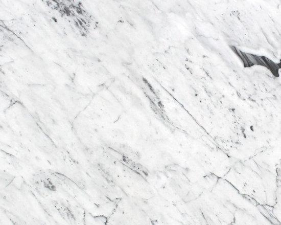 Marble Calacatta Statuary Slab - A BRIGHT WHITE BACKGROUND WITH A COMBINATION OF HEAVIER GRAY AND GOLD VEINING.