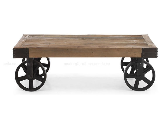 Zum Modern - Barbary Coast Cart Table - An industrial chic coffee table once used to transport furniture, fabric and supplies across the factory floor. The rustic nature of the solid elm wood works beautifully with the neutral colors and textures. Antiqued metal plates and carriage bolts adorn each corner for both the industrial look and for strength, best part...it's mobile!