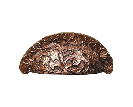 """Inviting Home - Florid Leaves Bin Pull (antique copper) - Hand-cast Florid Leaves Bin Pull in antique copper finish; 4""""W x 1-1/2""""; C to C = 3""""; Product Specification: Made in the USA. Fine-art foundry hand-pours and hand finished hardware knobs and pulls using Old World methods. Lifetime guaranteed against flaws in craftsmanship. Exceptional clarity of details and depth of relief. All knobs and pulls are hand cast from solid fine pewter or solid bronze. The term antique refers to special methods of treating metal so there is contrast between relief and recessed areas. Knobs and Pulls are lacquered to protect the finish. Detailed Description: The design of Florid Leaves pulls and Florid Leaves Bin Pulls is reminiscent of the Ginkgo plant with the Ginkgo berries. Ginkgo is believed to be a great source of energy and that is what the pulls itself portrays. The wispy leafy branches looks as if they are swaying in the wind by the way that they are twisting and turning into all kinds of directions. They would go beautifully with the Florid Leaves knobs"""
