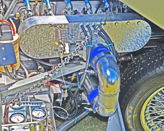"""www.WilliamBrionart.com photo gallery - Photograph by William Brion, """"Controlled Explosion"""", of a racing car's engine compartment with the turbo clamped on to the engine block. I took this photo and pushed the color intensity and the color saturation to emphasize the design beauty of the parts involved in racing cars and how they interact with efficiency to utilize the space within the engine compartment. ( Gallery 5 )"""
