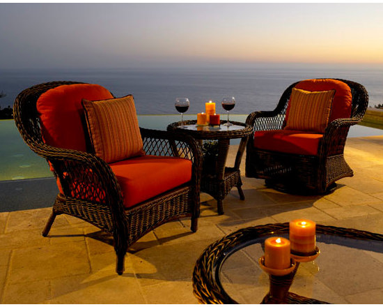 Berkshire Chairs - Cool-touch HDPE resin wicker in our richly toned cappuccino thick weave extrusion • Plush deep seating cushions in your choice of Sunbrella fabric • All cushion seams sewn with Tenara thread from the Gore Company • Lightweight, yet sturdy commercial-grade aluminum frame • Swivel rockers and other motion pieces are some of the most comfortable in the industry • Full line available including dining