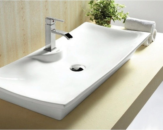 "Caracalla - Modern Curved Rectangular Vessel Bathroom Sink by Caracalla - Above counter vessel sink made of white ceramic. Perfect for modern style bathrooms, this sink comes with a single faucet hole and has no overflow. Caracalla designed this sink in Italy. Sink dimensions: 32.28"" (width), 6.06"" (height), 16.22"" (depth)"