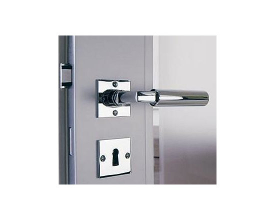 Chrome Polished Door Handles - This door handle and lock piece is contemporary, stylish and attention-grabbing. Made in polished chrome stainless steel, your doors will command the room.