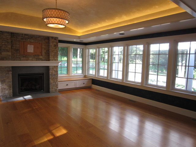 Sunroom with stone fireplace, tray ceiling, LED lighting, leather finishes, wide - Transitional ...