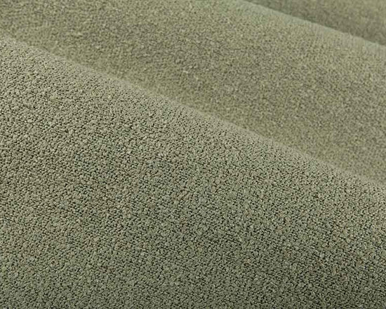Neela Upholstery Fabric in Moss Green - Neela Upholstery Fabric in Moss is a nubby green fabric. This discount fabric could be used to incorporate green or a variety of other neutral colors into interior designs. Made from 100% polyester, this heavy-duty, durable upholstery fabric passes 100,000 double rubs on the Wyzenbeek Abrasion Test. Cleaning Code: S; UFAC: Class I; passes CA117 Test. Width 54″.