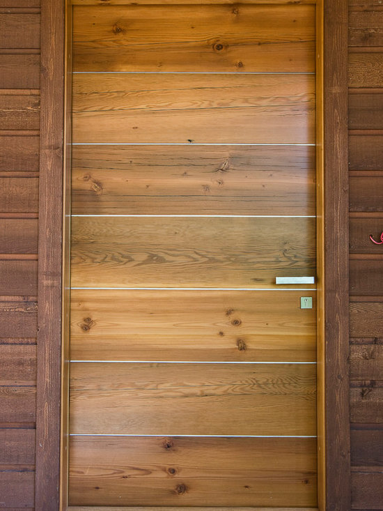 River City Woodworks in Fernie BC - Modern Doors - Reclained Douglas Fir with Aluminum bars between the planks