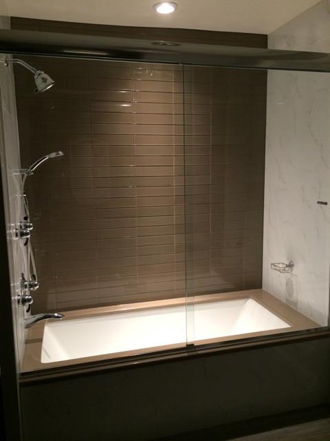Soaker tub with custom frameless glass sliding doors, Philadelphia - Contemporary - Bathroom ...