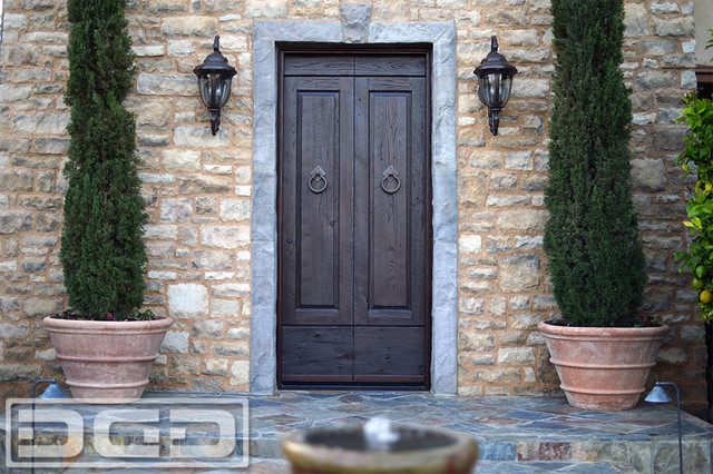 Custom made tuscan style entry door in reclaimed barn wood for Barn style front door