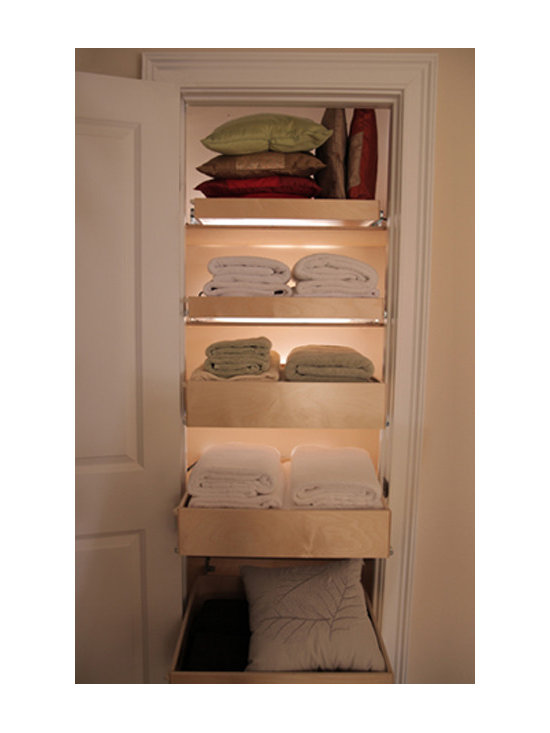 ShelfGenie Glide-Out Shelves - Install pull out shelves wherever you need more organization.  Linen closet, anyone?  Get an extra blanket without starting an avalanche.