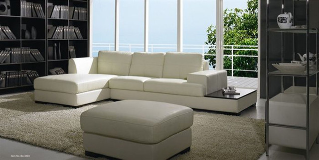 High End Tufted Leather Sectional With Chaise
