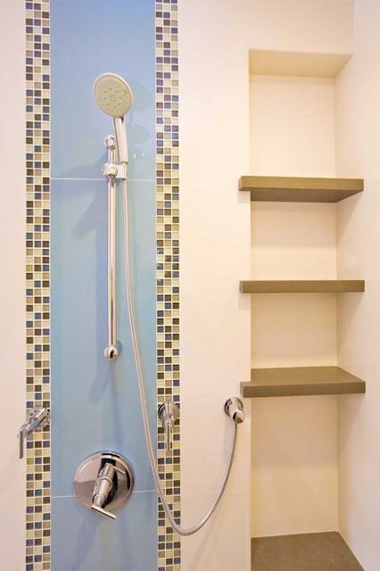 Shower with Porcelanosa tile and niche shelves modern bathroom