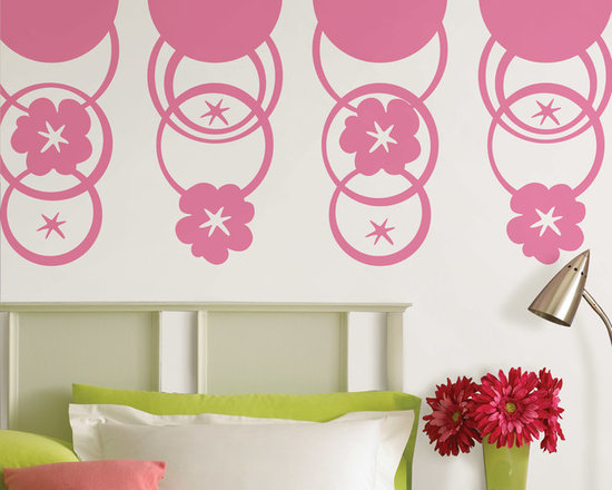 "Flirt Pink Dots and Hooplah Set of Wall Decals - Round and round we go...fun concentric circles create very cool walls. This pack contains twelve pink die-cut circles on four 13"" x 13"" sheets and eight 13"" Flirt Pink WallPops. WallPops are repositionable and always removable."