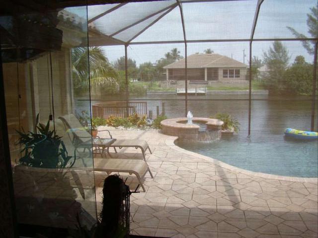 Storm Catcher Hurricane Screen tropical-windows-and-doors