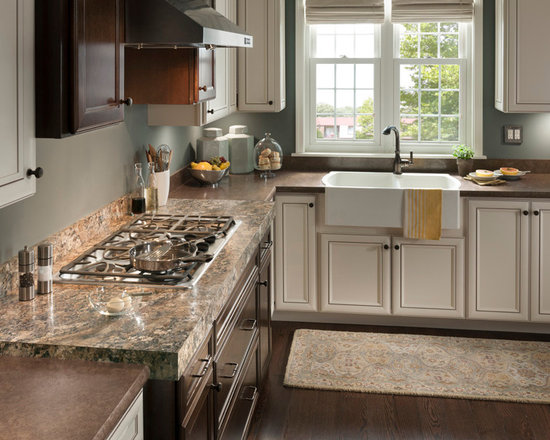 Winter Carnival & Luna Crest, Wilsonart HD - This kitchen features two Wilsonart® HD® designs. The Winter Carnival cooktop mirrors luxurious, exotic granite out of Brazil that includes rich red-brown colors with accents in cool grey. The Luna Crest countertops showcase various hues of bronze within a monochromatic design.