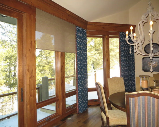 Window Coverings - Solar screen shades deflect glare yet allow filtered view out ! They can be controlled manually with a beaded chain or by a handheld remote & powered by battery or hard wire motorization .