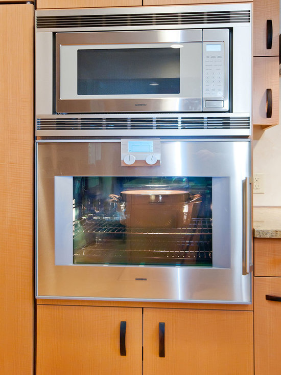 Gaggenau Oven and Microwave - Gaggenau oven and microwave. One reason that our client selected Gaggenau is that the oven door has a side hinge, so that you don't have to lean over the oven door. This photo is from an award-winning kitchen remodel in the San Francisco Bay Area by Bill Fry: http://www.billfryconstruction.com/