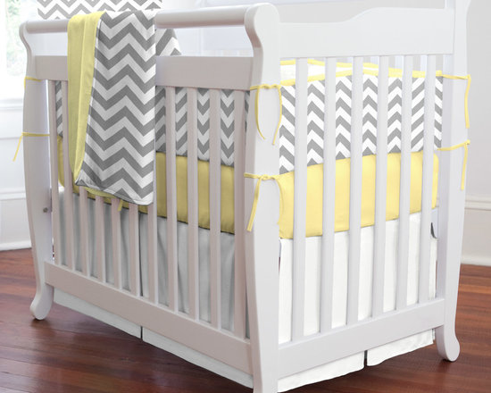 """Gray and Yellow Zig Zag - Bold, modern and contemporary best describes this nursery collection. Featuring our white and gray chevron design on soft 100% cotton twill, this collection is the perfect gender neutral bedding for your new arrival. This collection will bring years of enjoyment to your family. Perfect for smaller nurseries or for staying at Grandma's, portable mini-cribs are a great space-saving alternative to standard sized cribs. Our mini-crib bedding is designed to fit portable cribs using mattresses measuring approximately 24"""" x 38""""."""