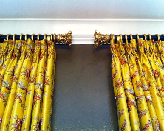 Drapery Ideas - Lush silk stationary side panels.  Gorgeous gilded gold brackets, rings and finials combined with a black pole.  Design by Michael Meloy.  Installation by Curtain Pros.