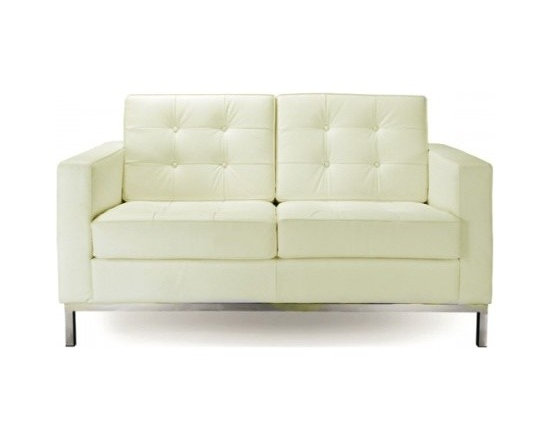 Florence Knoll Style Loveseat Italian Leather Ivory - Florence Knoll, an acclaimed architect and designer, first conceived this beautiful chair in 1956. Knoll's philosophy for furniture design comes from the value that she placed on practicality and aesthetic beauty. The pieces resulting from her philosophical vision are considered to be minimalistically beautiful without compromising on durability and comfort. Knoll was also known to study and collaborate with renowned architect and designer Mies Van Der Rohe, this collaboration also lended a hand in her highly sought after artistic vision. The classic trio was designed by Knoll using a durable stainless steel frame with minimal materials. The chair features beautiful cubic cushions complimented with compressed buttons in a functional layout which provides both style and comfort to the thin, minimalist supporting arms. The Knoll Sofa, Loveseat, and Chair are becoming more and more highly desired as their minimal yet practical design can adapt perfectly into today's modern home or space.