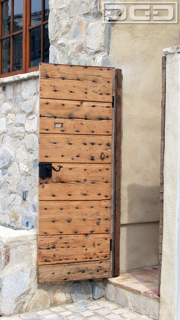 ... European Gate Retrofit With Architectural Hardware rustic-front-doors