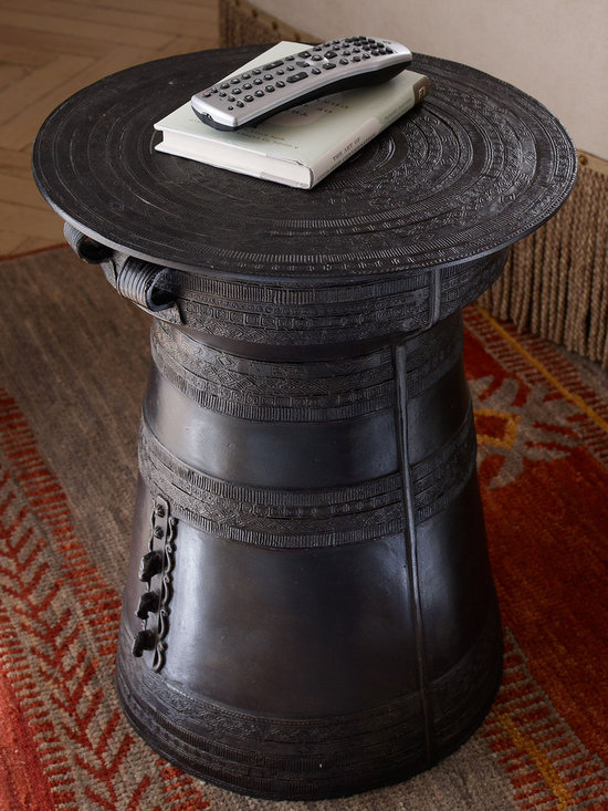 """Rain Drum - Used in festivals and ceremonies for thousands of years, the Southeast Asian rain drum is named for the unique sounds it makes when struck. Our intricately detailed reproduction makes a unique side table, or just enjoy it as decorative art. Made of aluminum with an antique-bronze finish. 16""""Dia. x 20""""T. Use indoors; if placed outdoors, use only in a covered area. Imported."""