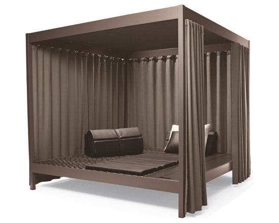 "CITY CAMP Daybed by Annette Hinterwirth - The CITY CAMP collection by Austrian designer Annette Hinterwirth offers a remarkable new interpretation of the DEDON concept of the Outdoor Living Room. Taking inspiration from the base camps of ancient explorers, which served as gathering places away from all infrastructure, Hinterwirth has conceived CITY CAMP as an all-in-one outdoor living unit for modern nomads. ""Wherever you are,"" she says, ""by the sea, in the desert or on a metropolitan rooftop, CITY CAMP is your retreat, your shelter, a place to eat, drink, relax, sleep or just be with family and friends. It can even be used as an outdoor guest bedroom."""