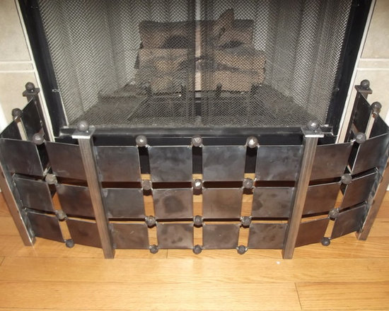 Modern Fireplace Fender - This design was the mastermind of Lynne Catron, designer at Fresh Perspective Design and Decor, LLC, Germantown, TN. This piece was used on a client's patio to corral plants inside a rustic fireplace mantle. More pictures to come.The color is the natural metal finish. Add $25 for paint or $75 for powder coat.