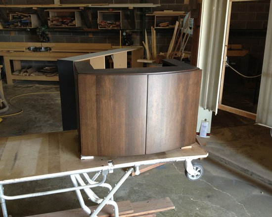 Curved Front Walnut Veneer Vanity Cabinet - This custom vanity cabinet was created for a high-rise remodel and features walnut veneer over flexible plywood, keeping the cost reasonable while allowing the curved front.