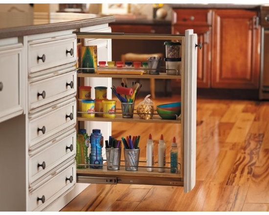 Getting Organized with Fieldstone Cabinetry - Pull out spice rack being used to store craft items at a handy height.