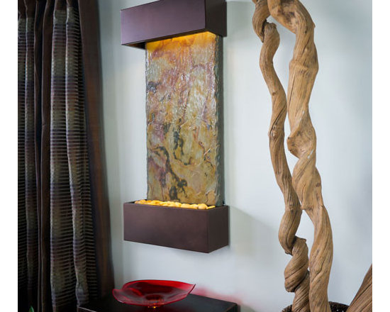 """Bluworld - Falling Leaves VerticalLightweight Slate Fountain - Oil Rubbed Bronze - Our Falling Leaves slate showcases the beautiful swirling colors of fall, warm and inviting reminiscent of """"falling leaves"""". The Oil Rubbed Bronze trim is a sophisticated semi-matte finish certain to blend with any decor. The vertical fountain panel is made of genuine slate bonded with a composite material for an extremely lightweight design that can be installed in 30 minutes or less. Water gently flows down the Falling Leaves slate face into a basin filled with polished river rocks. Easily adjust the flow of water with the included flow valve. The dimmable, remote controlled LED lighting highlights the soft cascade of water creating a dramatic focal point in any room or office.Falling Leaves Vertical includes long-lasting super bright white LED lights rated for over 10,000 hours of use and an ergonomic finger slide remote control to easily dim or brighten the LED lights or turn them on and off. This water fountain glistens as water sheets over the genuine Indian Slate flowing passed polished river rock creating a soothing sound and beautiful focal point for any room. This fountain is engineered with Bluworld's clog-free, splash-free design and features the Water Wonders NSI�� genuine light weight Slate. Installation is super easy with the lightweight nature of the NSI�� slate panels. Simply hang on the wall per the instructions. Once it's installed, your only concerns are setting the flow rate and turning on the accent light with your handy remote.This water fountain can be customized with your logo. Etched and hand-painted logos start at only $395.00. Contact our sales department for more information at 1-888-499-5433.Free freight is only available in the 48 Contiguous United States. Please contact us so that we can provide you with a quote when shipping to Alaska, Hawaii, other US territories or international."""