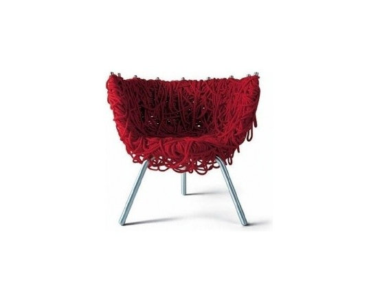Eco Friendly Furnture and Lighting - Skillful manual weaving of 500 meters of rope form the padding and cushion of this wrap-around armchair on a metal frame. Available in green, blue, red, black.