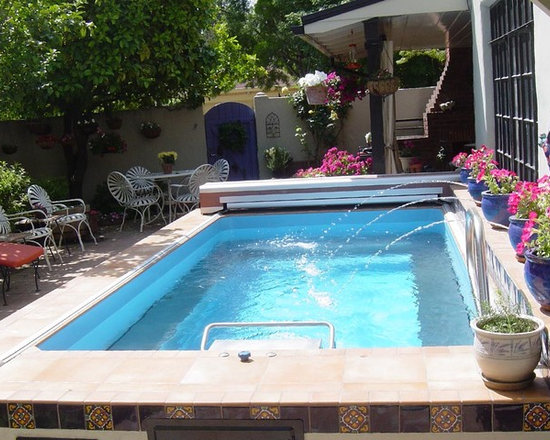 Original Endless Pools®, Small Pool - Our Design Specialists have customized thousands of unique Endless Pool installations. This owner chose to include fountains and ornamental tile on the skirting; cobalt blue planters make a striking accent.