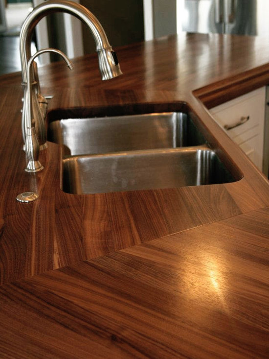 Walnut Wood Countertop - 3″ thick Edge Grain Walnut Kitchen Counter with Large Classical Bead & Cove on top edge, 1/8″ Roundover on bottom horizontal edges, 1″ Roundover on vertical corners and a Durata® permanent waterproof finish in satin. Designed by Showplace Kitchens of Fargo.
