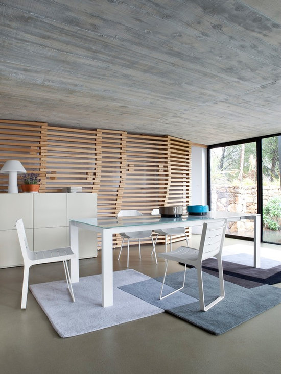 Bianco - Ligne Roset - Bianco dining table, Aluchair dining chairs, Intersections rug.