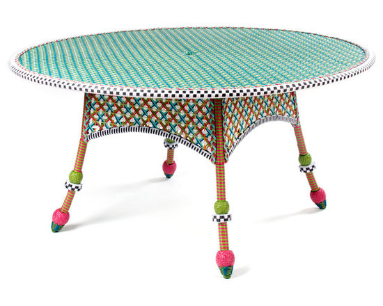 Greenhouse Outdoor Round Dining Table | MacKenzie-Childs - The glorious hues of summer inspire the Greenhouse Collection. Intricately woven of resin wicker in shades of green, pink, white, and orange, and embellished with acrylic roses and leaves. Solid iron frame. Sturdy, easy care, and made to withstand the elements. Includes center opening for use with a market umbrella. Seats 4-6 comfortably.