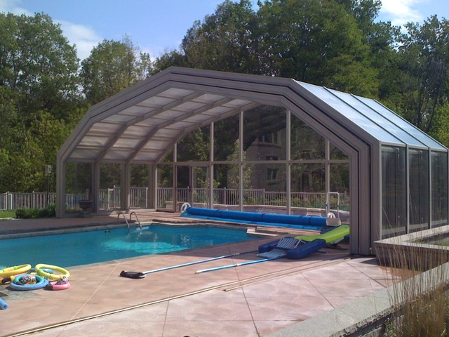 Retractable pool enclosures open with a push of a for Garden pool covers