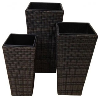 Trio of Rattan Planters modern-outdoor-pots-and-planters
