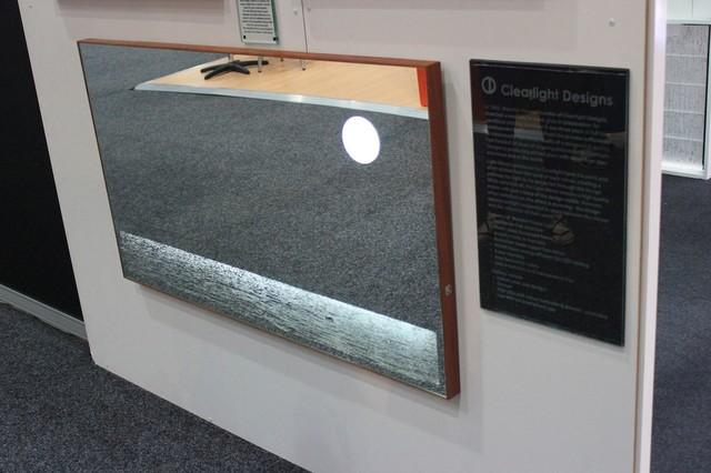 Timber framed light mirror on display in sydney beach