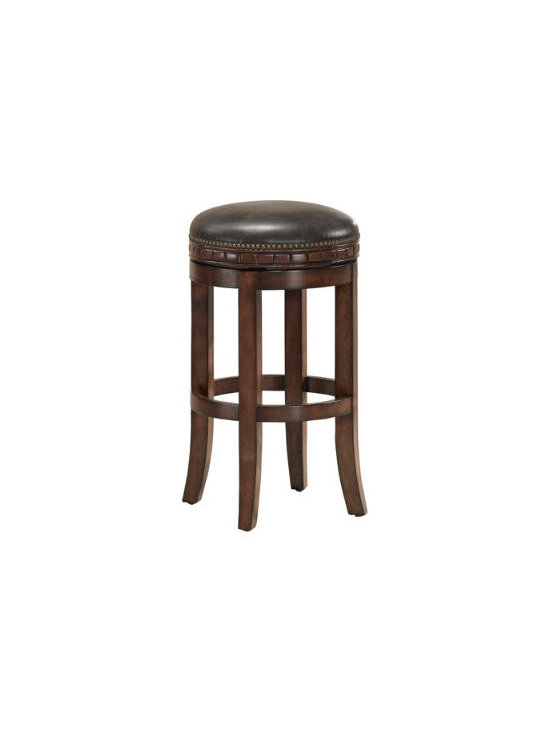"""Grandin Road - Tempo Bar Stool - Round, backless swiveling leather stool. Leather-bonded seat with a 3""""-thick cushion. Handsome nailhead trim and carved details. Full 360° ball-bearing swivel. Mortise and tenon hardwood birch construction. Undeniably chic and handsome, our classic Tempo leather stool makes the most comfortable perch in the kitchen or at the bar.. . . Full 360 degrees ball-bearing swivel. . Equipped with adjustable leg levelers. Arrives fully assembled."""