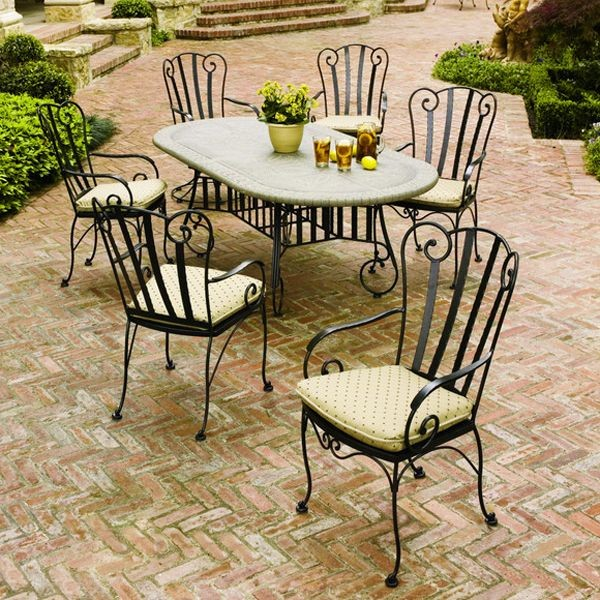 Wrought iron outdoor dining table and chairs for Metal patio table and chairs